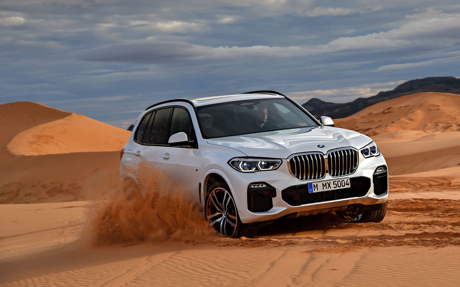 Comparison Bmw X5 Xdrive50i 2019 Vs Gmc Yukon Denali