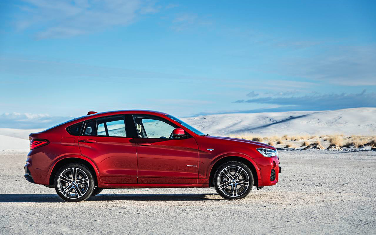 Comparison Bmw X4 M40i 2018 Vs Land Rover Discovery Sport Se 2018 Suv Drive