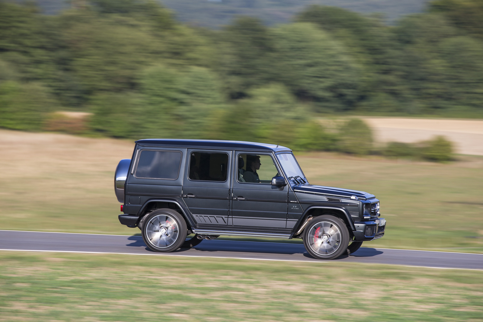 Comparison mercedes benz g class 2016 vs cadillac for Mercedes benz g class pictures
