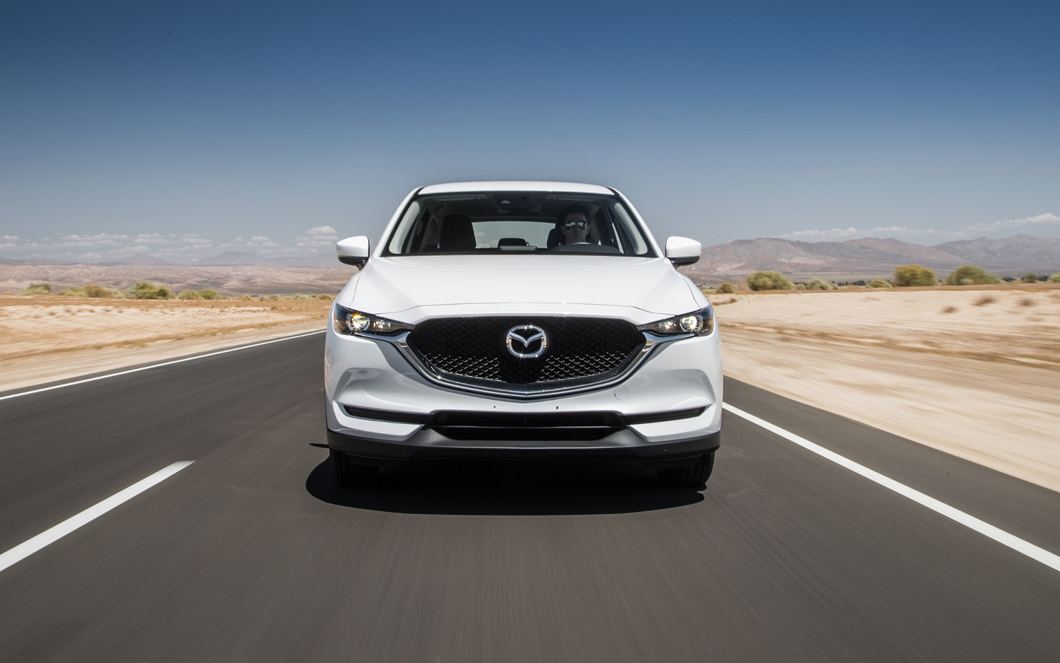 Mazda Mazda I Grand Touring Review