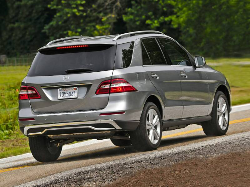 Comparison mercedes benz m class ml63 amg 2015 vs for Mercedes benz that looks like a jeep