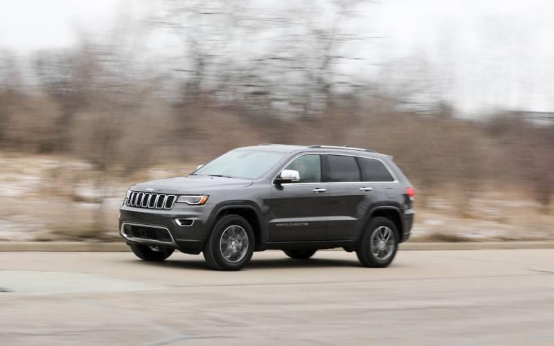comparison jeep grand cherokee overland   volkswagen atlas    suv drive